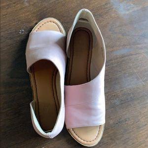 Open toe flats.